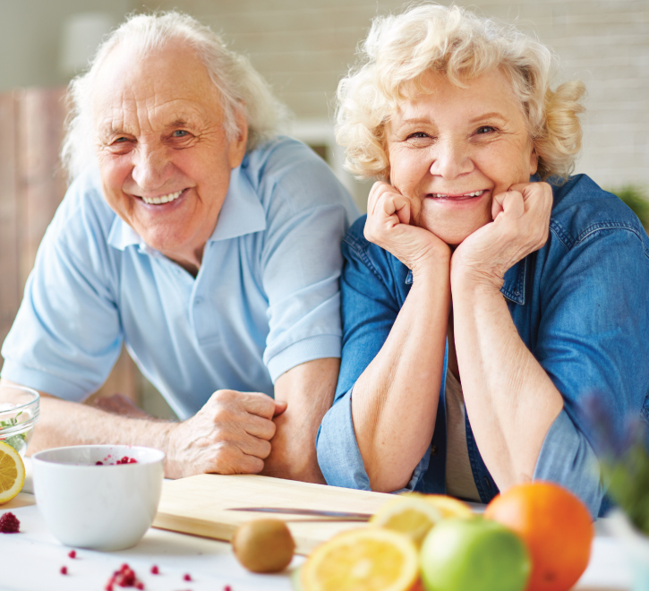 Couple preparing a healthy snack in their cottage kitchen.
