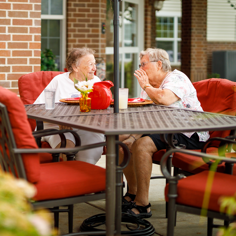 Two women having conversation on the patio